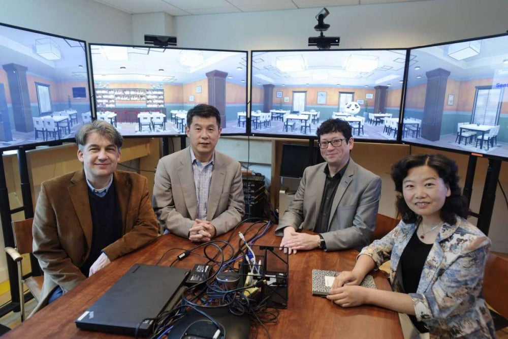RPI professors, Jonas Braasch, left, associate director of CISL, Hui Su, second from left, director of CISL, Ben Chang, third from left, professor of arts, Games Simulation Arts and Sciences and Jianling Yue, Chinese lecturer, pose for a photo on Thursday, June 7, 2018, in Troy, N.Y. The four professors are working on the Mandarin Project