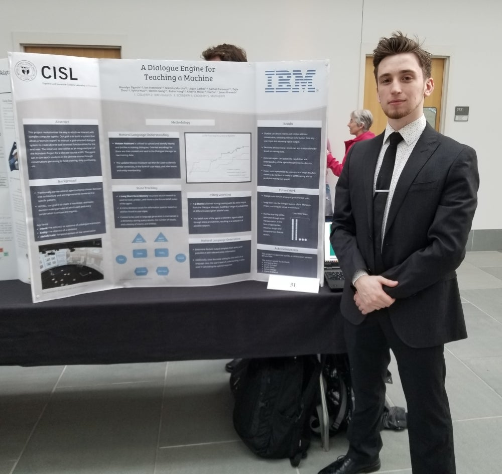 Brandyn Sigouin and his poster that won an honorable mention at the 2019 Undergraduate Research Symposium.